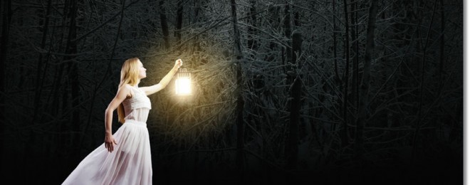 30275596 - young woman in white long dress walking in night wood